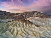 Eroded cliffs and sunrise from Zabriskie Point. Death Valley National Park, California